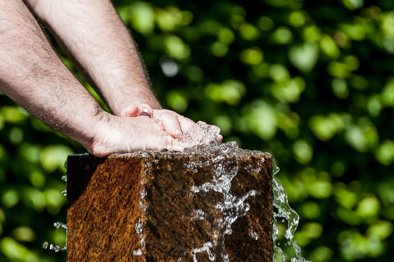 Two hands on a fountain
